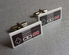 @Aretha Gaines what about these?  Lol nintendo controller cufflinks by pixelparty on Etsy, $25.00.