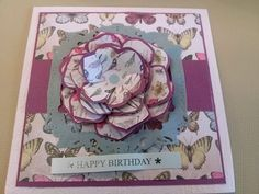this started life as an just going to be a band of card across the middle with one layer of teal turquoise colour card and three simple little flowers but it sort of grew like topsy! And this is why I hardly ever plan layouts in advance, cos they never end up the way they were originally in my head!