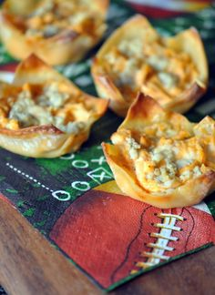 Buffalo Chicken Cups.  12 oz of cooked chicken, diced  3 oz of blue cheese, crumbled  ¼ cup of wing sauce (mild or hot, according to taste)  ½ cup of cream cheese, softened  24 wonton wrappers (found in the refrigerated section of your store)  Cupcake Pan  Preheat oven to 400 degrees