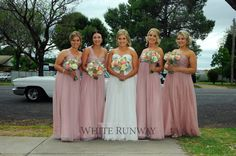 High school sweethearts Rebecca Welsh and Jacob Eppelstun tied the knot in their hometown Eugowra, NSW. Rebecca's gorgeous bridesmaids wore the Darling Dress by Jadore in Dusty Pink.