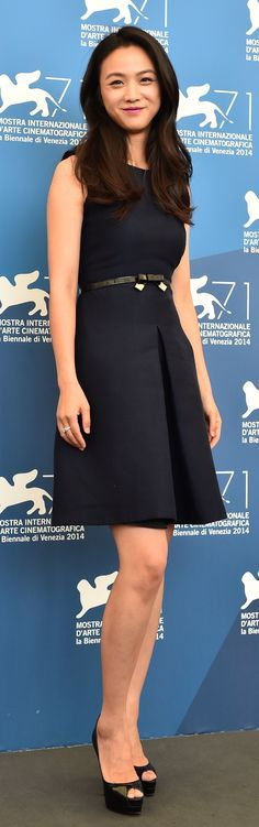 Chinese actress Tang Wei wearing a navy Burberry dress to attend the 71st Venice Film Festival