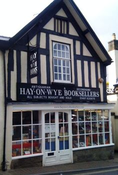 I love Hay-on-Wye, England.  The village is filled with used book shops (even the castle is one) and cozy tea shops.  Perfect for a day of browsing through book shops and resting in a charming tea shop enjoying tea and crumpets.