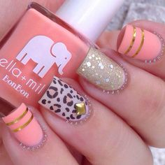Play around with the metallic gold strips and add a delicate shine on the pink, leopard print and glitter nails.