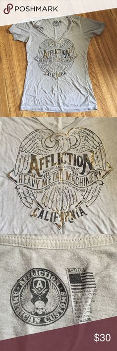 Affliction women's tshirt I've worked at buckle for two years and have accumulated clothes I've only worn a few times!! This is an affliction tshirt. It is very soft and very cute. I just never ever wear it. It's been wore probably 4 times in the 1 1/2 years I've had it. WILLING TO NEGOTIATE Affliction Tops Tees - Short Sleeve
