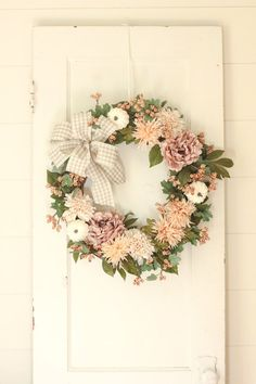 Fall Wreath ~ Fall Door Wreath ~ Fall Farmhouse Wreath ~ Autumn Wreath A beautiful fall pumpkin, peony, eucalyptus, spider mum and berry wreath. This wreath features all of the farmhouse goodness of fall. It is all attached to a natural grapevine base. A beautiful indoor or outdoor wreath. The