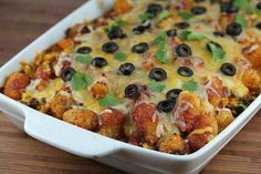 Taco tater tot casserole 1 lb ground beef 1 small diced onion 1 minced clove garlic 1 small can sliced olives 1 oz package taco seasoning 16 oz frozen corn 4 Oz can diced green chilies (drained) 12 oz can black beans (drained and rinsed) 16 oz shredded Mexican cheese 16 oz bag frozen tater tots 10.5 oz can enchilada sauce 375 for 40 min