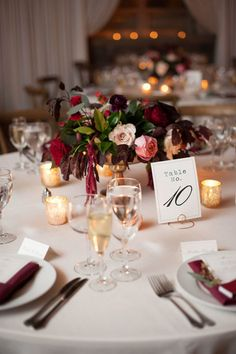 Deep Burgundy and Greenery Wedding Centerpiece with pops of blush and gold // low and lush, fall, romantic, classic