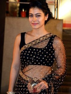 Kajol in an amazing black and gold saree