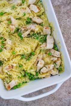 Garlic Parmesan Spaghetti Squash with Chicken and Peas Recipe - spaghetti squash is a great swap for pasta in this savory recipe!