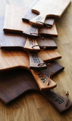 5 Loaves 2 Fish French Style Cutting Boards with handles and leather straps.
