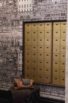 Perhaps instead of wall paper could use a graffiti? nice contrast with mailboxes.   Cole + Son Wallpaper. Interior by Andrea Kantelberg.
