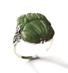 SOLD. Vintage Art Deco green glass & sterling silver ring, crazed moulded glass cabochon, possibly ancient, with marcasite setting. https://www.etsy.com/inglenookery/listing/225317339/vintage-art-deco-green-glass-sterling