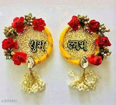 Religious Idols & Paintings Elite Shubh-Labh Hangings For Diwali Festival Material : Flowers  Size: 6 in Description: It Has 1 Sets Of Doors Shubh-Labh Hangings For Diwali Festival Work: Pom Pom & Beads Country of Origin: India Sizes Available: Free Size   Catalog Rating: ★3.9 (1307)  Catalog Name: Elite Trendy Shubh-Labh Hangings For Diwali Festival Vol 1 CatalogID_425486 C128-SC1316 Code: 891-3103431-913