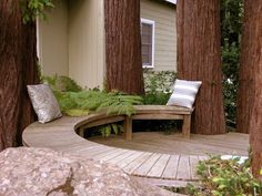 Imagine having these huge redwoods in your backyard and incorporating them into this deck and curved bench.