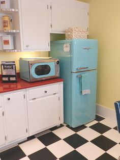You're going to love this kitchen!  Turquoise is the color theme of this house
