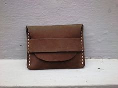 It's a handmade leather wallet from Waterproof leather with  these dimensions : 10.5cm X 8.0 cm / 4.1 in X 3.1 in.