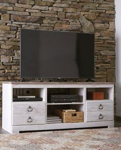 The Willowton Tv stand by Ashley Furniture adds the perfect touch of vintage farmhouse charm to your entertaining area