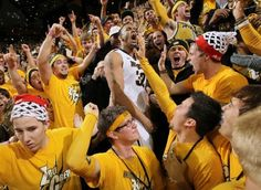 "Feb 4, 2012 - Mizzou's Steve Moore celebrates with the crowd.  - With Missouri headed for the SEC Conference, this was the last MU-KU game in Columbia.  ESPN's ""College GameDay"" was there.  The #4 Tigers rallied from eight down with 2:08 left to beat #8 Kansas 74-71 in a game that featured 15 lead changes and seven ties.  Missouri scored the last 11 points of the game."