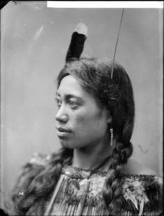 Portrait of a young Maori woman with a moko, long plaits, and a huia feather in her hair. Photographed by William Henry Thomas Partington in early . Native American History, American Indians, Polynesian People, Maori People, Maori Designs, Nz Art, Maori Art, First Nations, Old Photos