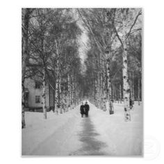 A couple walking through a snow covered road art photo