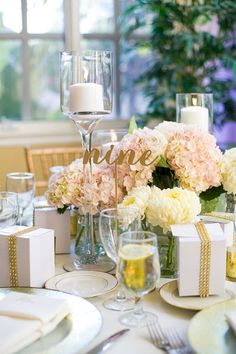 The gold accents, the pillar candles, the cream and pink hydrangeas and that laser-cut calligraphy table number! A gorgeous table setting for a modern chic wedding. {Photo courtesy of Callawaygable}