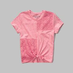 This super cute tee is made with delicate patchwork detailing at front and yoke, crew neckline, tie at hem, heritage logo detail at hem, self fabric interior neck taping, easy fit, imported