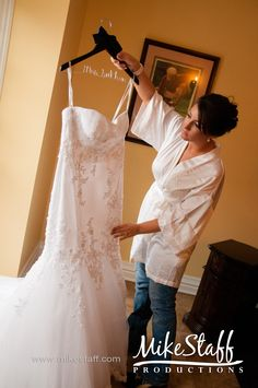 Looking at dress before putting on