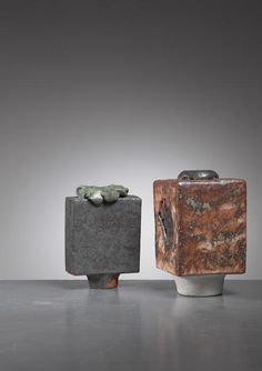 A pair of sculptural ceramic vases by German ceramist Lotte Reimers (1932).  The measurements stated are of the anthracite and green vase. The brown piece is 9 by 9 cm and 16 cm high.  Signed by Reimers with the years of production (1973 and 1979).
