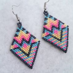 Check out this item in my Etsy shop https://www.etsy.com/listing/466716773/neon-aztec-design-beaded-earrings