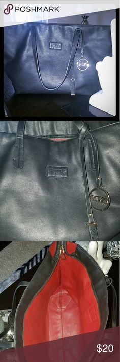 """BCBG Paris Black and Red Tote Handbag BCBG Paris Womens Handbag Large Purse Travel Tote 20"""" - 13"""" Is in good condition except for a small area on one strap where cloth has come off ( see picture # 4) Interior is a red color, soft material Pretty gold bcbg ornaments BCBG  Bags Totes"""