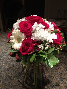 Wildrose Floral Design Wedding Gallery. This is a mixed Bridal Bouquet - so lovely and so elegant - and simply perfect for a wedding in any month. Contact at wildrosefloraldesign.net or check it out on Facebook.