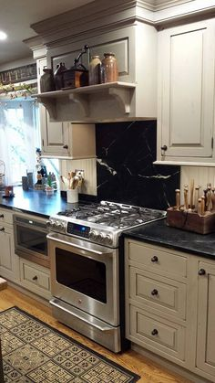 My Country kitchen - soapstone backsplash and countertops - dual fuel stove - drawer microwave - custom kitchen by Design Solutions, Inc. in Delaware