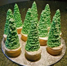 These are cupcakes I made for a Christmas party. It's ice cream cones covered with green buttercream icing, silver balls and sprinkled with powered sugar.
