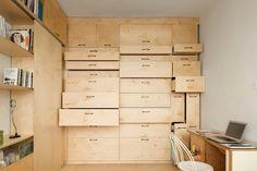 Attractive wooden wall of storage. DIY