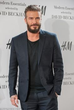 Suave: The retired footballer wore a blue suit with a black T-shirt with his neat but bushy beard