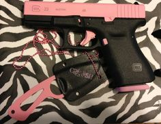 The latest STS Defense Cerakote project. Glock 23 with matching neck knife for my girl.