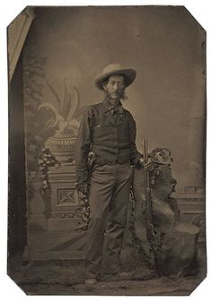 TINTYPE OF A COWBOY AND HIS RARE WHITNEY RIFLE