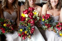 Deep red bouquets with pops of yellow and purple |  Photographer: JS Fotos