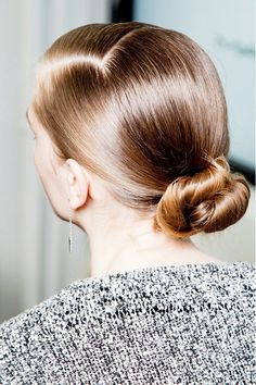 sleek low bun with side part