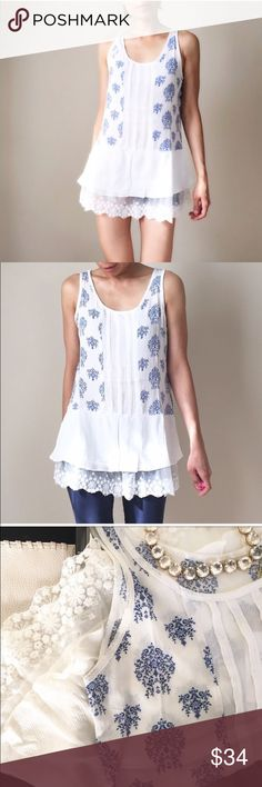 """Tunic top with extended ruffle lace Sleeveless tunic top with extended lace ruffle bottom. Light ethereal tunic top. 100% rayon . Size s: length 29"""" bust :36"""" w: 36"""", size M: 29"""",37"""",37"""". Size L; 30"""",b38"""",w38"""". No trade.           Follow me on  INSTAGRAM: @chic_bomb  and FACEBOOK: @thechicbomb CHICBOMB Tops Tunics"""