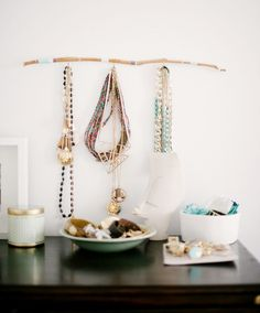 This is one clever and creative idea. It's also one I haven't seen before. Utilize a Branch to store jewelry.