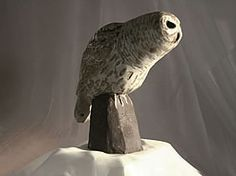 Stoneware Barred Owl sculpture is a classic from our ceramic birds collection