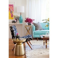 Love chair & gold side table. Blue lamp, artwork, rug, mid-century legs for chairs & tables. DO NOT LIKE COUCH.   Photo by designlovefest