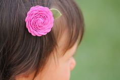 My daughter needs a little more hair first but this rick rack hair clip is cute and looks easy.