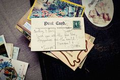 Vintage postcards for guests to write a message on the back, instead of a conventional guest book. Like the idea, but really needs a scrapbook as well for the postcards afterwards ...