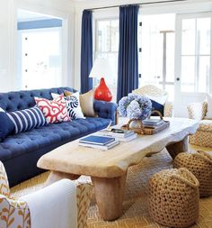 This coastal living room is framed with navy draperies and anchored with a navy  sofa  The sofa is filled with red  white and blue pillows coralThrow Pillows   Summer Color Combo  Navy Blue   Orange   Pure  . Navy Sofa Living Room. Home Design Ideas