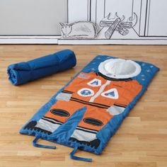 Commencing countdown to sleepover.  Space suit sleeping bag designed by artist Jon Cannell is ready.  The appliqued and embroidered details have been deemed irresistibly playful.  Add your little astronaut's name for a personal touch, and begin the final sequence to take-off.