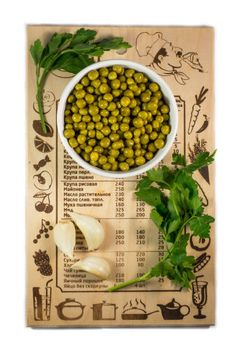 peas on a cutting board on a white background vegetables on the board