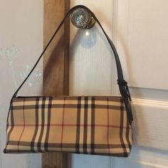 Burberry bag In good condition. A little dirty inside. Corners have few scuffs ( see pictures). Zippers work good. Cute little bag :) authentic Burberry Bags Shoulder Bags