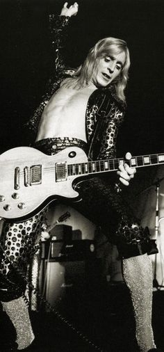 Mick Ronson on stage.